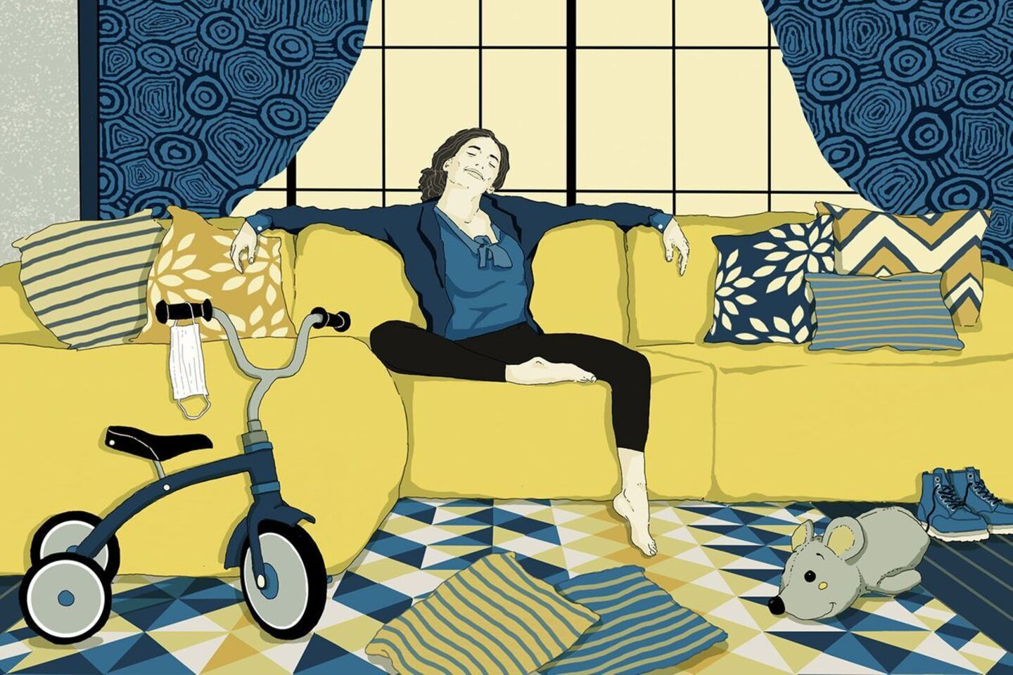 Woman relaxing on couch in a house